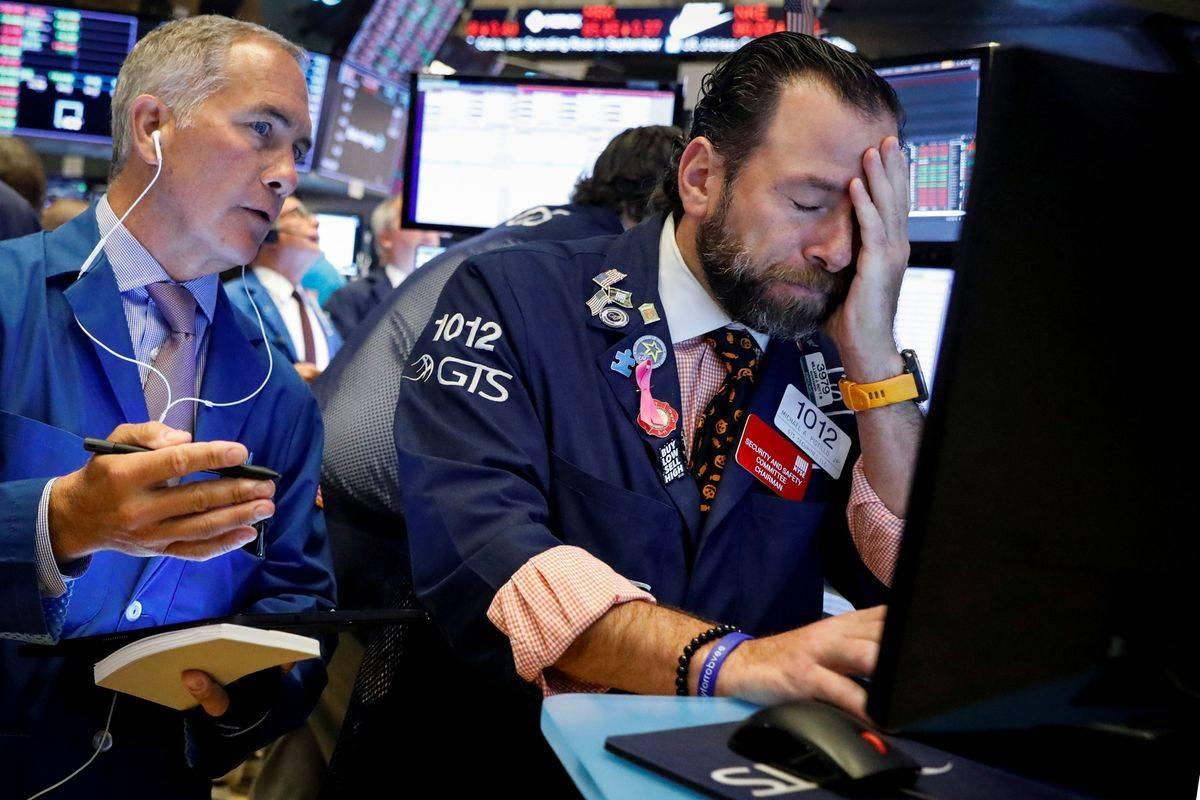 Delniški indeks Dow Jones, ki ga sestavlja 30 elitnih ameriških podjetij, je v zadnjem tednu zdrsnil za 2,5 odstotka, s tem je bil tudi celoten januar negativen. Gre za prvi negativni mesec Dow Jonesa po avgustu. Tehnološki indeks Nasdaq je ohranil pozitivni trenutek, januarja se je njegova vrednost povzpela za dva odstotka. Foto: Reuters