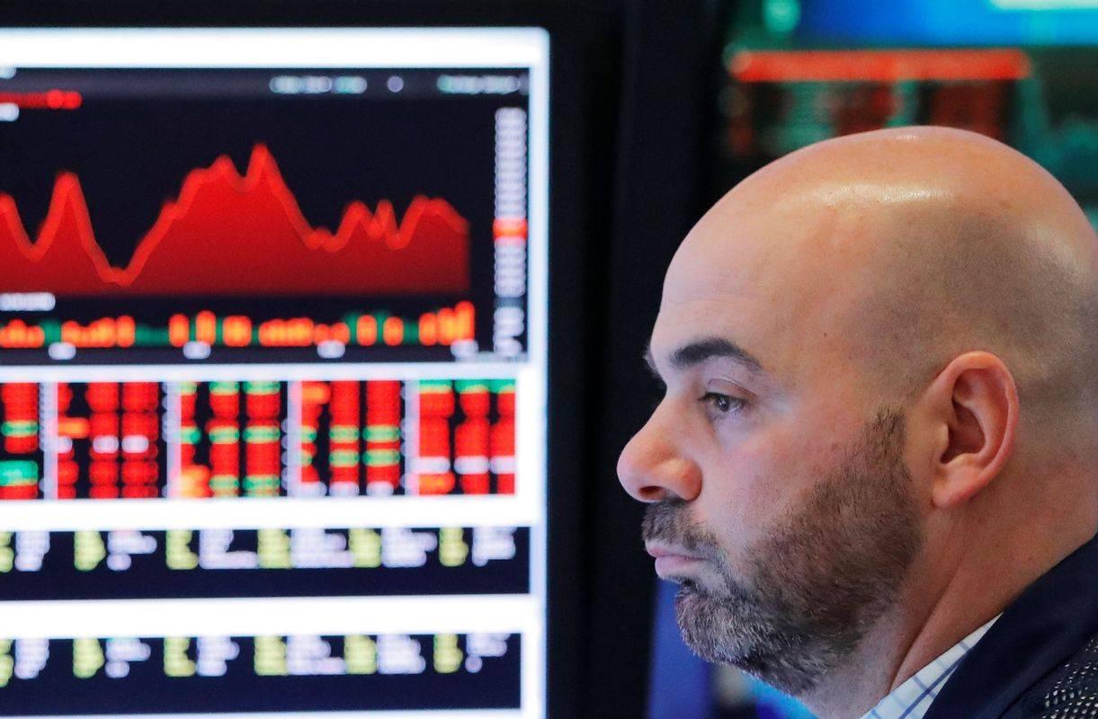 Newyorški delniški indeks Dow Jones je zadnji teden izgubil 2,7 odstotka, frankfurtski DAX30 pa štiri odstotke. V Ljubljani so bila gibanja pozitivna, SBITOP je pridobil 1,8 odstotka, potem ko so se Telekomove delnice podražile za štiri odstotke, Krkine pa za 2,7 odstotka. Foto: Reuters