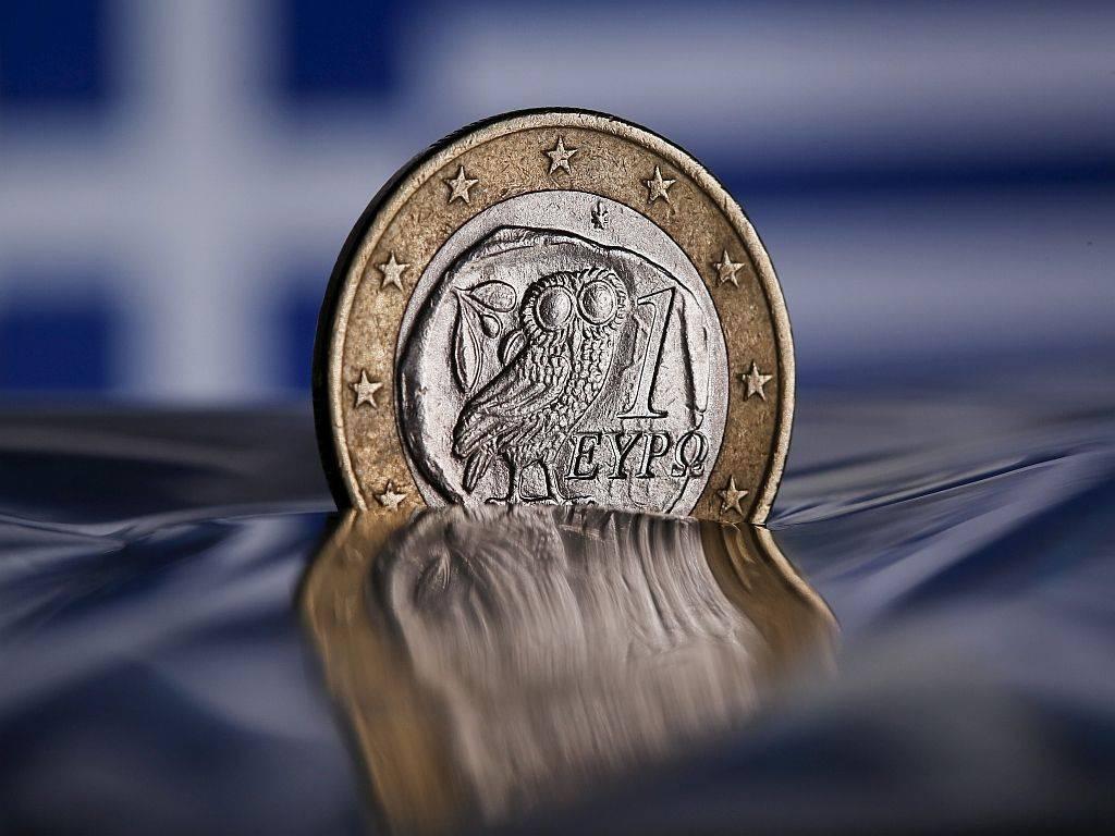 Grčija se je izkopala iz krize, a po deležu dolga v BDP-ja ostaja visoko zadolžena (skoraj 200 odstotkov). Foto: Reuters