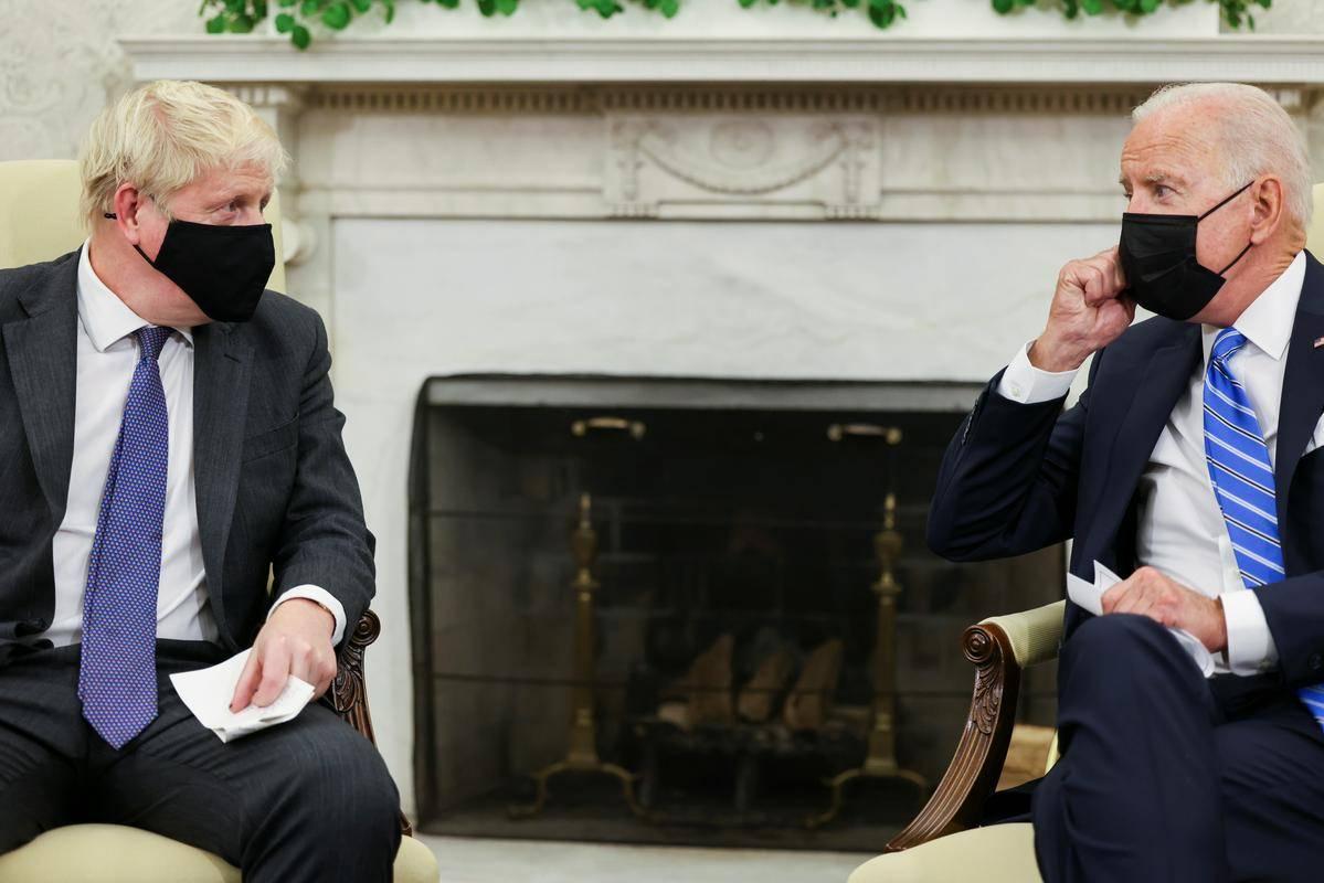 Johnson in Biden na prvem sestanku v Beli hiši. Foto: Reuters